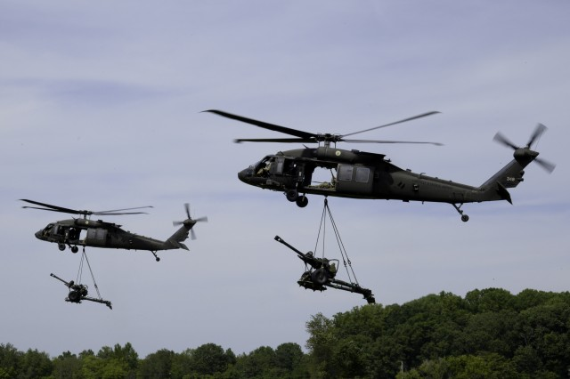 Soldiers with the 101st Airborne Division (AASLT) participate in a demonstration August 25, 2017 at Fort Campbell, KY. The demonstration is in honor of the Division's 75th Birthday.