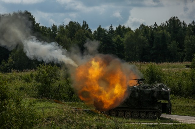 Soldiers of 3rd Armored Brigade Combat Team, 4th Infantry Division, Fort Carson, Colorado fire a M109A6 Paladin howitzer while conducting a live fire training during Exercise Combined Resolve IX at the Grafenwoehr Training Area, Germany, Aug. 21 2017. Exercise Combined Resolve IX is designed to train the Army's Regionally Allocated Forces to the U.S. European Command. The goal of the exercise is to prepare forces in Europe to operate together to promote stability and security in the region