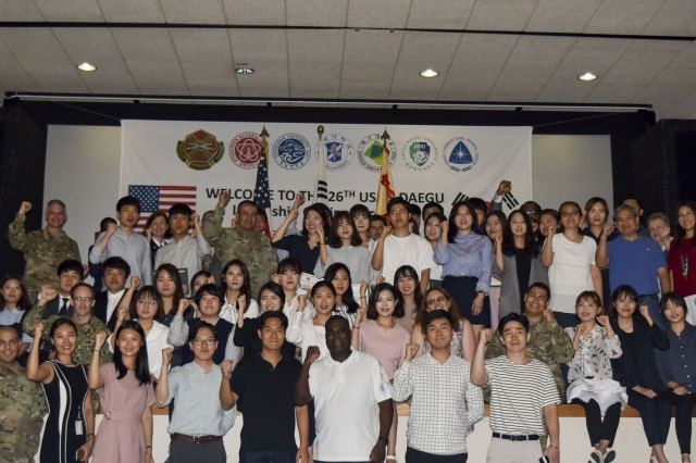 United States Army Garrison Daegu 2017 Spring Session interns and supervisors gather on the platform for group photo, Aug. 18, at the Camp Henry Theater.