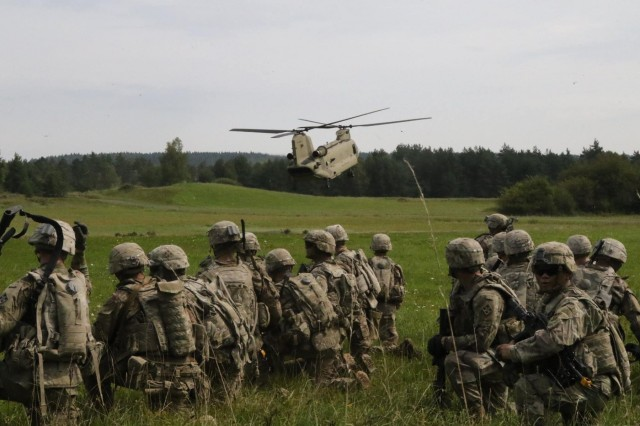 "Infantrymen with Company A, 1st Battalion, 8th Infantry Regiment, 3rd Armored Brigade Combat Team (""Iron Brigade""), 4th Infantry Division, conduct an air assault with the 3rd General Support Aviation Battalion, 10th Combat Aviation Brigade during the U.S. Army Europe Combined Resolve IX exercise at the 7th Army Training Command's Grafenwoehr Training Area, Germany, Aug. 24, 2017. CbR IX was the Iron Brigade's fourth and final brigade-level exercise to enhance readiness to deter aggression in Europe while serving in support of Operation Atlantic Resolve. (U.S. Army photo by Staff Sgt. Ange Desinor, 3rd Armored Brigade Combat Team, 4th Infantry Division)"
