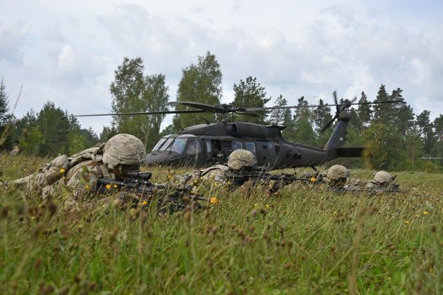 "Infantrymen with Company A, 1st Battalion, 8th Infantry Regiment, 3rd Armored Brigade Combat Team (""Iron Brigade""), 4th Infantry Division, conduct an air assault with the 3rd General Support Aviation Battalion, 10th Combat Aviation Brigade during the U.S. Army Europe Combined Resolve IX exercise at the 7th Army Training Command's Grafenwoehr Training Area, Germany, Aug. 24, 2017. CbR IX was the Iron Brigade's fourth and final brigade-level exercise to enhance readiness to deter aggression in Europe while serving in support of Operation Atlantic Resolve."