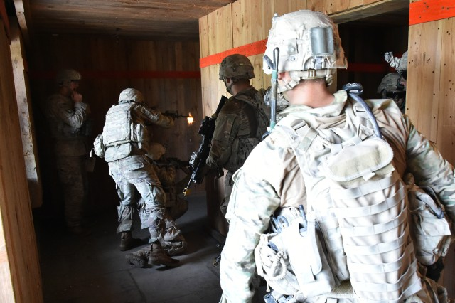 "Infantrymen with Company A, 1st Battalion, 8th Infantry Regiment, 3rd Armored Brigade Combat Team (""Iron Brigade""), 4th Infantry Division, clear a building during an air assault mission during the U.S. Army Europe Combined Resolve IX exercise at the 7th Army Training Command's Grafenwoehr Training Area, Germany, Aug. 24, 2017. CbR IX was the Iron Brigade's fourth and final brigade-level exercise to enhance readiness to deter aggression in Europe while serving in support of Operation Atlantic Resolve."