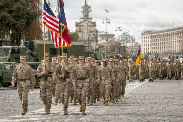 Oklahoma National Guard Soldiers from the 45th Infantry Brigade Combat Team march alongside Ukrainian troops and other NATO allies and partners during a parade in Kyiv, Ukraine on Aug. 24, to celebrate Ukrainian independence.The 45th IBCT Soldiers are currently deployed to Ukraine in support of the Joint Multinational Training Group-Ukraine, an international coalition dedicated to building the training capacity of the Ukrainian Army. The U.S. will continue to train and advise Ukrainian forces until 2020. (Photo by Sgt. Anthony Jones, 45th Infantry Brigade Combat Team)