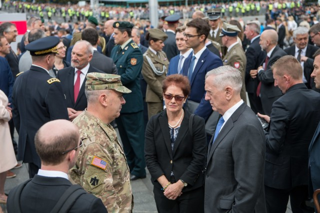 Secretary of Defense Jim Mattis and U.S. Ambassador to Ukraine Marie Yovanovitch speak to the commander of the U.S Army's 45th Infantry Brigade Combat Team, Col. David Jordan in Kyiv, Ukraine, on Aug. 24, 2017.45th IBCT Soldiers were the first ever U.S. troops to participate in the Ukrainian celebration.The 45th is deployed to Ukraine in support of the Joint Multinational Training Group-Ukraine, an international coalition dedicated to building the training capacity of the Ukrainian army. (DOD photo by U.S. Air Force Staff Sgt. Jette Carr)