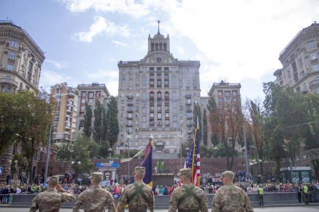 Oklahoma National Guard Soldiers from the 45th Infantry Brigade Combat Team salute as Ukrainian President Petro Poroschenko passes their formation during a parade in Kyiv, Ukraine on Aug. 24.The 45th IBCT is currently deployed to Ukraine in support of the Joint Multinational Training Group-Ukraine, an international coalition dedicated to building the training capacity of the Ukrainian Army. The U.S. will continue to train and advise Ukrainian forces until 2020. (Photo by Sgt. Anthony Jones, 45th Infantry Brigade Combat Team)