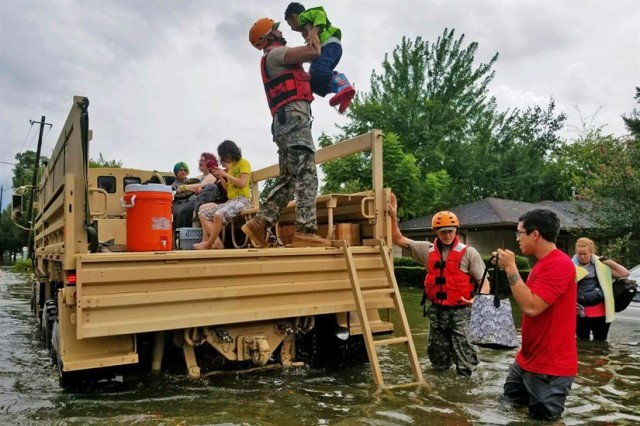 Texas National Guard soldiers assist residents affected by flooding caused by Hurricane Harvey in Houston, Aug. 27, 2017.