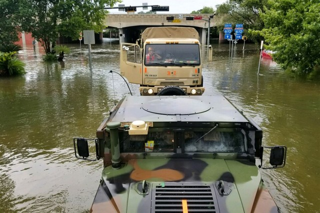 Texas National Guard vehicles assist in search and rescue operations in Texas following Hurricane Harvey, Aug. 27, 2017.