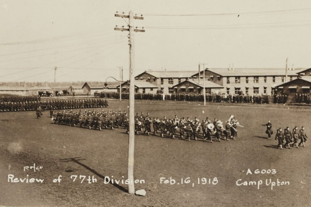 Soldiers of the 77th Division, manned by New York City area draftee Soldiers, conduct a review on Feb. 16, 1918 at Camp Upton, Yaphank, N.Y. ( Liibrary olf Congress)