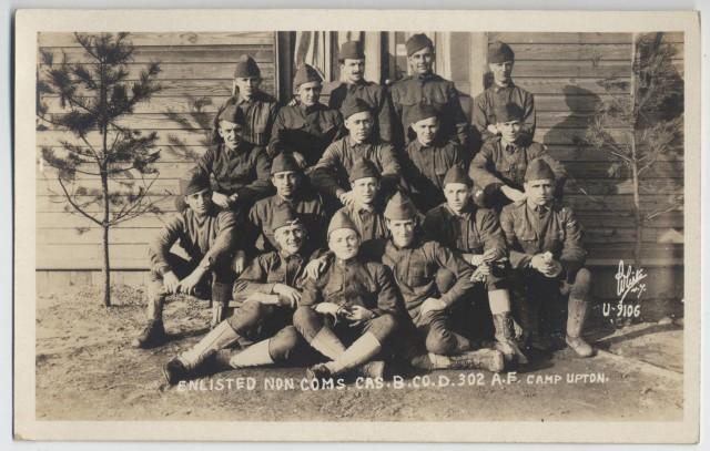 77th Division NCO's pose