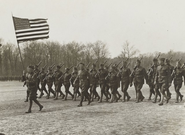 77th Divison Soldier in Blessing of the Flag ceremony