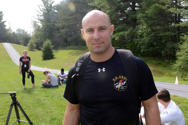 Sgt. Nick Cunningham, bobsled driver, poses for a photo beside the summer push track at Lake Placid, N.Y., Aug. 23, 2017.