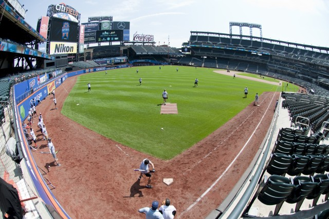 The New York City Army softball team, consisting of Soldiers from Fort Hamilton, New York and the U.S. Army's New York City Recruiting Battalion, take the field against the combined Marines/Coast Guard team in the first round of the 3rd annual Mets Military Softball Classic Aug. 21, 2017 at Citi Field in New York City. The Army came into the game as defending champions, but lost this year's title to the Navy/Coast Guard team. (U.S. Army photo by Master Sgt. Jeremy Crisp/Released).