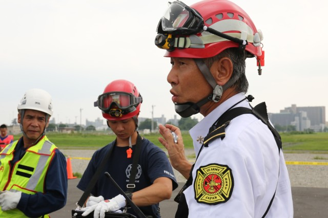 Akira Nakajima, assistant fire chief from Sagami General Depot's Directorate of Emergency Service for USAG Japan, gives his team directions Aug. 21, 2017 as operation section chief during the USAG Japan's full-scale exercise on SGD. (U.S. Army photo by Noriko Kudo)