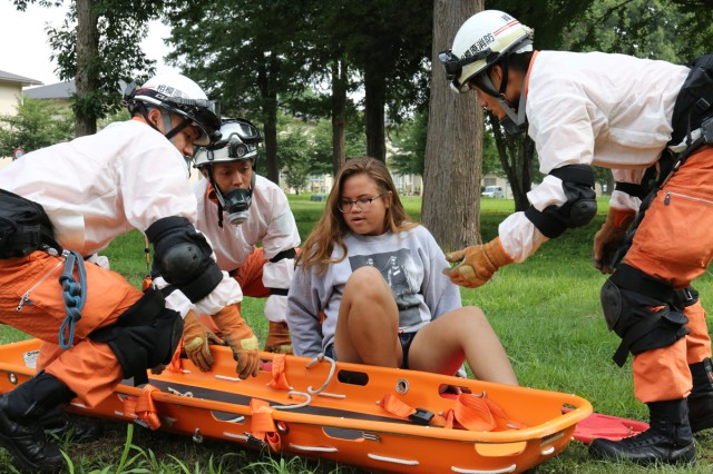 The first responders from Sagamihara city rescue a volunteer casualty Aug. 22, 2017 during the USAG Japan's full-scale exercise on Sagamihara Family Housing Area. (U.S. Army photo by Noriko Kudo)
