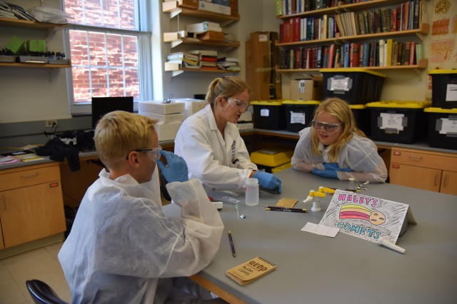 Haley Sherman (center), a Near Peer Mentor, works with two students in the Environmental Science Laboratory at Hood College on August 2.