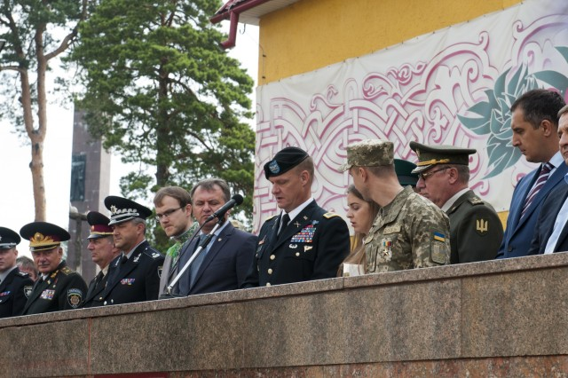 Col. Charles Booze, the deputy commanding officer of the 45th Infantry Brigade Combat Team and chief-of-staff for the Joint Multinational Training Group - Ukraine, delivers the commencement speech for the graduating class of the Hetman Petro Sahaidachny National Army Academy in Lviv, Ukraine on Aug. 26.The 45th IBCT is deployed to Ukraine as part of the Joint Multinational Training Group - Ukraine at the Yavoriv Combat Training Center on the International Peacekeeping and Security Center near Yavoriv, Ukraine. The JMTG-U is a coalition of nations dedicated to improving the CTC's training capacity and building professionalism within the Ukrainian army. (Photo by Staff Sgt. Eric McDonough, 45th Infantry Brigade Combat Team)