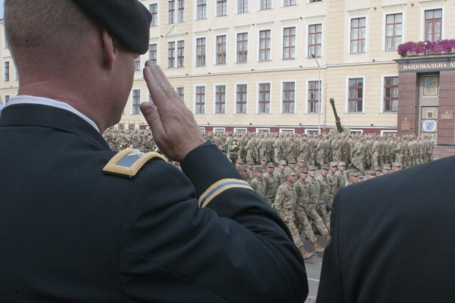Col. Charles Booze, the deputy commanding officer of the 45th Infantry Brigade Combat Team and chief-of-staff for the Joint Multinational Training Group - Ukraine, salutes as cadets pass-in-review at the Hetman Petro Sahaidachny National Army Academy in Lviv, Ukraine, on Aug. 26.The 45th IBCT is deployed to Ukraine as part of the Joint Multinational Training Group - Ukraine at the Yavoriv Combat Training Center on the International Peacekeeping and Security Center, west of Lviv. The JMTG-U is a coalition of nations dedicated to improving the professionalism within the Ukrainian army. (Photo by Staff Sgt. Eric McDonough, 45th Infantry Brigade Combat Team)