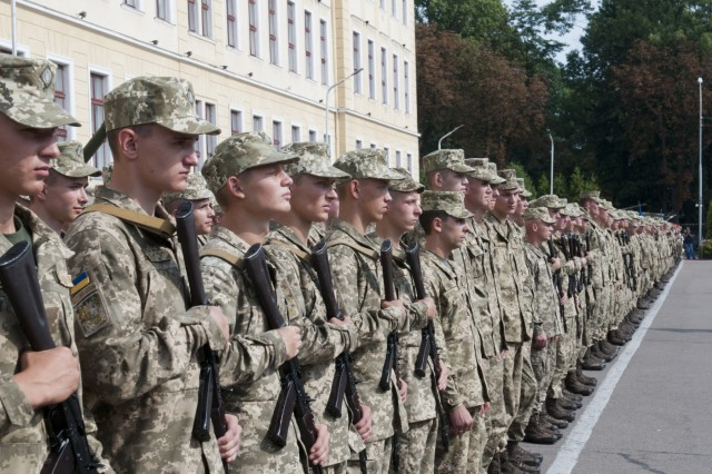 Graduating cadets, identified by carrying rifles, are joined by their classmates at the Hetman Petro Sahaidachny National Army Academy on the occasion of their commissioning into the Ukrainian Army in Lviv, Ukraine on Aug. 26. The Hetman Petro Sahaidachny National Army Academy was founded in 1899 and has continually produced military officers for no fewer than four different governments. (Photo by Staff Sgt. Eric McDonough, 45th Infantry Brigade Combat Team)