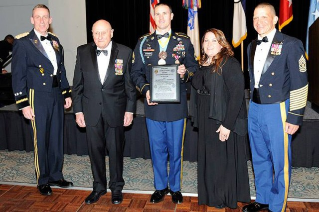 Sgt. 1st Class Brenden Shannon (center), is named I Corps' NCO of the Year for 2017 by Lt. Gen. Volesky, commanding general of I Corps, during the Army Birthday Ball at Joint Base Lewis-McChord, Wash. Shannon, a first sergeant with 5th Battalion, 20th Infantry Regiment, 1-2 Stryker Brigade Combat Team, later became U.S. Army Forces Command NCO of the Year for 2017.