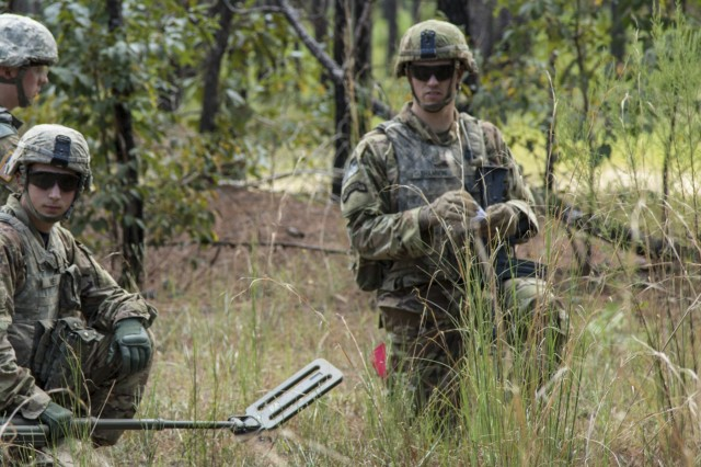 Sgt. 1st Class Brenden Shannon, (right) an infantryman from 5th Battalion, 20th Infantry Regiment, prepares an Unexploded Ordnance Report during the Counter Improvised Explosive Device event of the 2017 Forces Command Best Warrior Competition at Fort Bragg, N.C., Aug. 22. Fifteen noncommissioned officers and Soldiers are competing in a five-day competition designed to test their physical and mental endurance at Fort Bragg, N.C., Aug. 20-25.  (U.S. Army photo by Sgt. Jazmin Jenkins / 22nd Mobile Public Affairs Detachment)