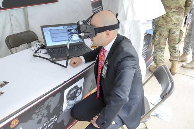 Dr. Marcello Pilia of the U.S. Army Medical Research and Materiel Command's Combat Casualty Care Research Program tests the I-Portal PAS tool - one of several emerging TBI detection devices - during a presentation at the Pentagon in May 2017.