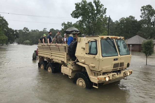 Texas Guard members from the 386th Engineer Battalion partnered with first responders from Texas Task Force One and the Cypress Creek Fire Department to move residents from severely flooded neighborhoods to safety days after Hurricane Harvey hit south Texas, August 28, 2017.