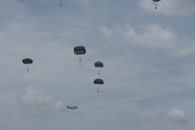 Soldiers from the 57th Sapper Company, 27th Engineer Battalion, 20th Engineer Brigade, descend under the T-11 parachute over Sicily Drop Zone, Fort Bragg, North Carolina.