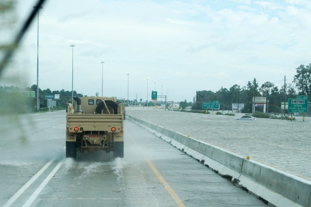 U.S. Army Reserve Soldiers with the 957th Quartermaster Company, the 223rd Support Maintenance Company, and the 300th Sustainment Brigade Headquarters Company drive through a flooded highway in support of recovery and relief efforts during Hurricane Harvey August 29, 2017 at the Federal Detention Center in Houston, Texas. Federal Law Enforcement officials requested support from the Army Reserve to deliver supplies and personnel to the detention center through the high-rising waters: a capability the Reserve LMTVs were able to provide.