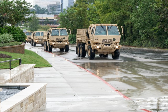 U.S. Army Reserve Soldiers with the 957th Quartermaster Company, the 223rd Support Maintenance Company, and the 300th Sustainment Brigade Headquarters Company drive to receive a mission in support of recovery and relief efforts during Hurricane Harvey August 29, 2017 in Houston, Texas. Federal Law Enforcement officials requested support from the Army Reserve to deliver supplies to the Federal Detention Center through the high-rising waters: a capability the Reserve LMTVs were able to provide.