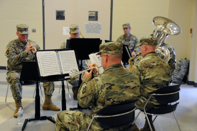 Soldiers assigned to the 101st Airborne Division Band provided a music ensemble in support of the Southeast Medical Area Readiness Support Group Change of Command ceremony held on Saturday, August 26, 2017.  U.S. Army Reserve Col. Scott Lynn, outgoing commander for SE-MARSG, relinquished command to incoming commander, Col. Bradley Nindl, at the ceremony held at Command Sergeant Major Huff U.S. Army Reserve Center in Nashville, Tennessee.  The Change of Command ceremony symbolizes the continuation of leadership and unit identity despite the change of individual authority.  It also represents the transfer of power from one leader to another; passing the ceremonial flag from outgoing to incoming commander is a physical representation of that transfer.