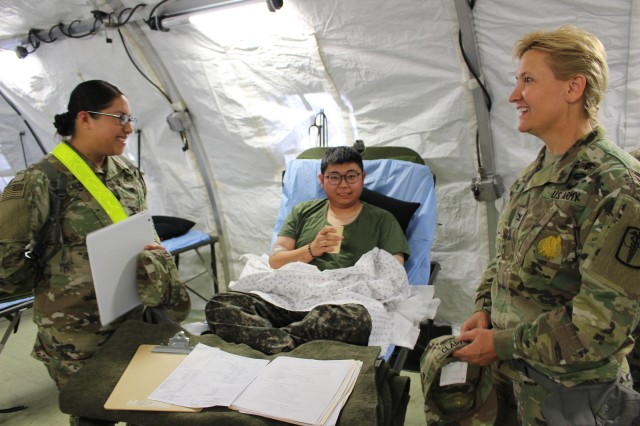 A ROK Army Soldier rests in ICW after medical treatment
