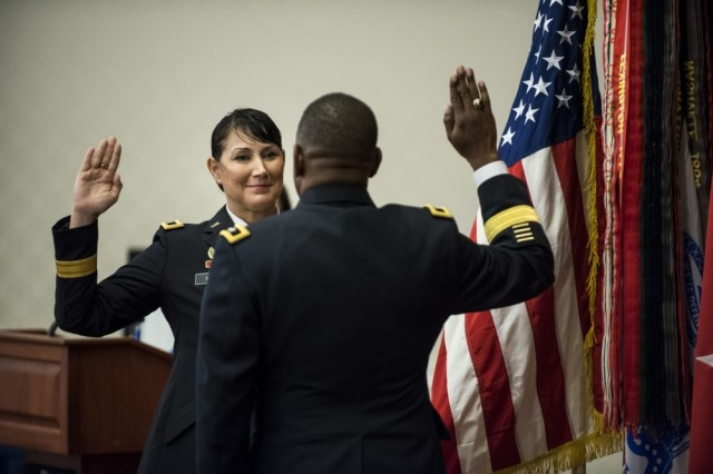 Brig. Gen. Irene Zoppi, U.S. Army Reserve deputy commanding general for the 200th Military Police Command, recites the oath of office after being promoted from the rank of colonel during a promotion ceremony held on Fort Meade, Maryland, Aug. 28, 2017.
