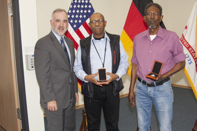 Michael Formica, director of IMCOM-Europe, presented James Bryant and Carnell Smith with the Vietnam Veteran Lapel Pin during town-hall ceremonies held Aug. 29.