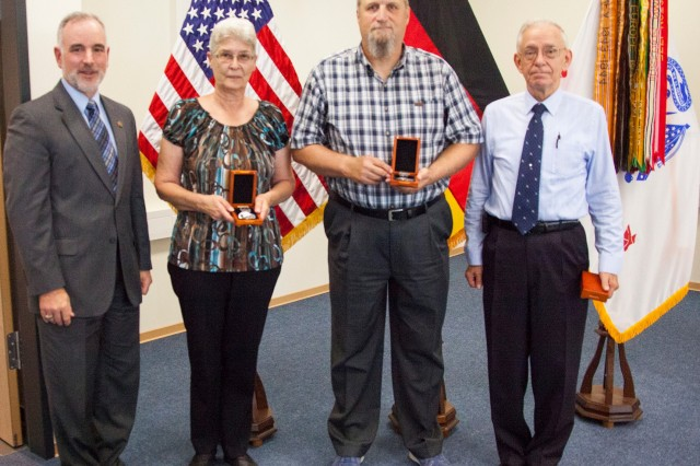 Michael Formica, director of IMCOM-Europe, presented Deborah McGlothlin, Rodney McGlothlin and Dave McCracken with the Vietnam Veteran Lapel Pin during town-hall ceremonies held Aug. 29.