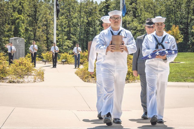 "Seaman Jason Rollins, left, and Seaman Nicholas Verver, right, students with the Navy Center for Seabees and Facilities Engineering Detachment, Fort Leonard Wood, lead the procession for the interment of Chief Petty Officer Arthur ""Bill"" Craft at the Missouri Veterans Cemetery - Fort Leonard Wood Aug. 24."