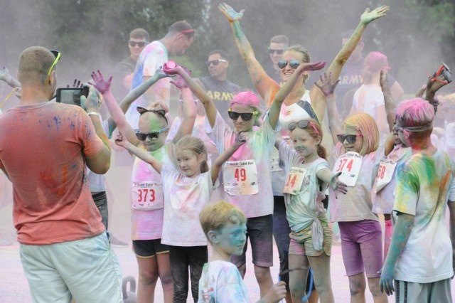 A family takes a photo after the 2017 Fort Rucker Color Run .
