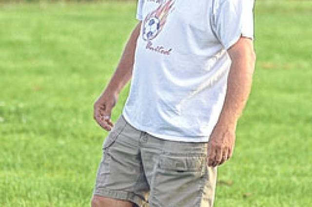 Jeff Cornuet, FLW United head coach, keeps an eye on the action Aug. 24.