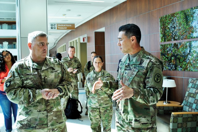 Army Chief of Staff Gen. Mark A. Milley, left, talks with Col. John Melton, commander of Irwin Army Community Hospital at Fort Riley, Kansas, about the staff and capabilities of the hospital Aug. 23. Milley, Sen. Jerry Moran and Maj. Gen. Joseph M. Martin, 1st Infantry Division and Fort Riley commanding general, toured IACH to learn more about its success and the staffs abilities to treat and care for Soldiers and their families.