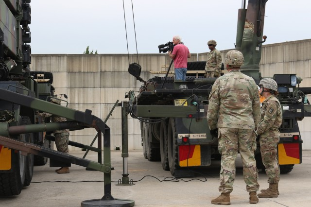 Kyle Eppler, NBC New's cameraman, films Soldiers from 6-52 Air Defense Artillery Battalion at the Battery D, 6-52 ADA Battalion, tactical site Aug. 30 in Osan Air Base, South Korea. The 35th ADA Brigade's mission is to provide air and missile defense operations to defend critical assets and enable United States Forces Korea combat power generation capabiliites.(U.S. Army Photos by Monik M. A. Phan)
