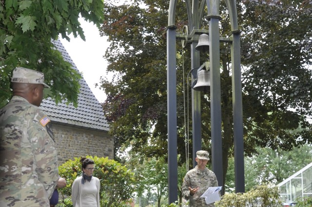Army Maj. Kevin Daul (right), deputy garrison chaplain at U.S. Army Garrison Benelux, spoke about Belgian Air Force Lt. Col. Joseph Daumerie's bravery and sacrifice before the bell-ringing ceremony Aug. 25, 2017 at Caserne Daumerie, Belgium. The chapel bells rang for one full minute to honor the 75th anniversary of Daumerie's death.