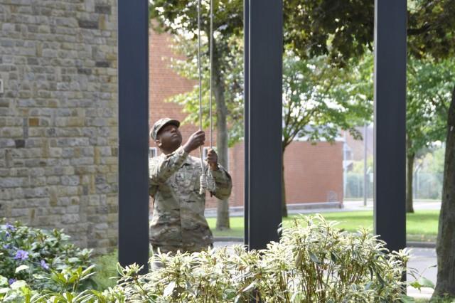 Army Staff Sgt. Reginald Ross, garrison chaplain NCOIC at U.S. Army Garrison Benelux, rang the bells during a ceremony Aug. 25, 2017 at Caserne Daumerie, Belgium. The chapel bells rang for one full minute to honor the 75th anniversary of Daumerie's death.
