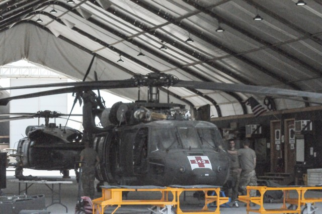 Soldiers of Company D, 2-149th General Support Aviation Battalion,29th Combat Aviation Brigade, conduct phase maintenance on a HH-60M Black Hawk helicopter for its first 480-hour phase maintenance cycle on August 5, 2017, at Taji Military Complex, Iraq. Proper maintenance on the Black Hawk helicopter enables the 29th CAB to provide aviation assets and aeromedical evacuation in support of Combined Joint Task Force - Operation Inherent Resolve and Operation Spartan Shield. CJTF-OIR is the campaign to defeat ISIS in Iraq and Syria. (U.S. Army Photo by Staff Sgt. Isolda Reyes)