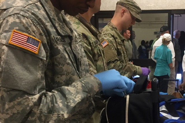 The Louisiana National Guard's 2228th Military Police Company receive Hurricane Harvey flood victims from southwest Texas at the LSU AgCenter mega-shelter in Alexandria, Louisiana, September 1, 2017. The LANG is continuing to provide around-the-clock emergency operations support in response to Harvey.