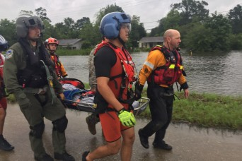 Hybrid team rescues handicapped man from Hurricane Harvey flooding with water, ground and air assets