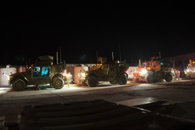 U.S. Army paratroopers, deployed in support of Combined Joint Task Force -- Operation Inherent Resolve and assigned to the 2nd Brigade Combat Team, 82nd Airborne Division, prepare a military armored tactical vehicle convoy in support of their advise and assist mission to Iraqi security forces maneuvering to liberate Tal Afar from ISIS in northern Iraq, August 20, 2017.