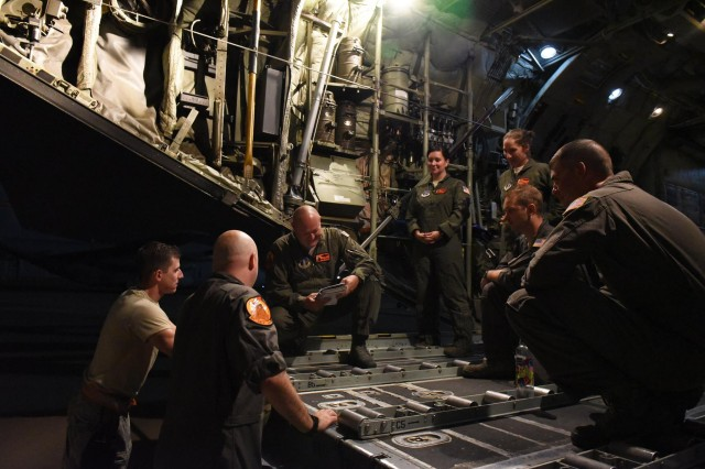 The aircrew of a C-130 Hercules flown by the 182nd Airlift Wing, Illinois Air National Guard, conduct a preflight brief before a late night departure from their home base of Peoria, Ill., September 2, 2017, to assist with preparations for Hurricane Irma.