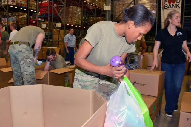 Captain Latrina Dudley, from St. Louis, MO, sorts through donated items at the San Antonio Food Bank warehouse.