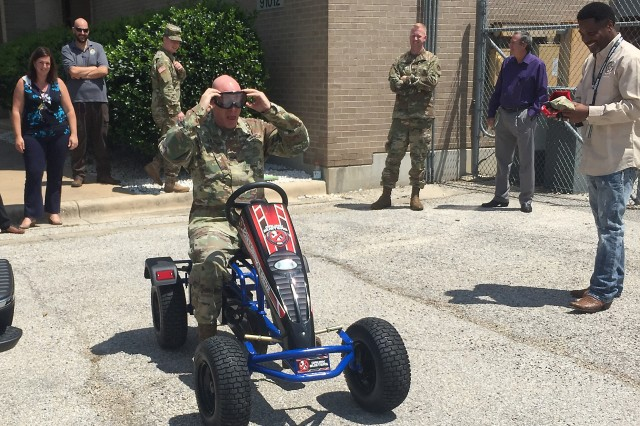 """Col. Ted. D. Yates, U.S. Army Operational Test Command's future operations officer, puts on """"drunk goggles"""" during directorate safety training Aug. 30 during the command's safety stand down."""