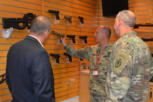 Col. Mark Shade, Fort Jackson deputy commander, left, and Maj. Gen. Pete Johnson, Fort Jackson commanding general, tour one of the display rooms last week as part of a professional development event at FN America's Columbia plant.