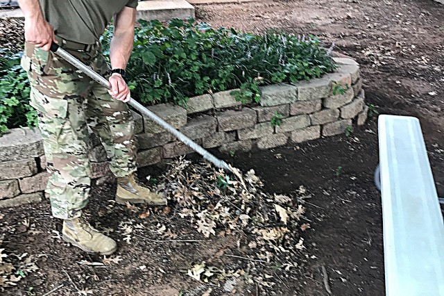 Pvt. Nicholas Chandler, B Battery 3rd Battalion, 2nd Air Defense Artillery, rakes leaves along the perimeter of Pioneer Park Elementary School in Lawton, Okla., Aug. 9, 2017. The exterior cleanup further cemented the battalion's commitment to its community partner through the Army Partnership with Local Area Schools program.